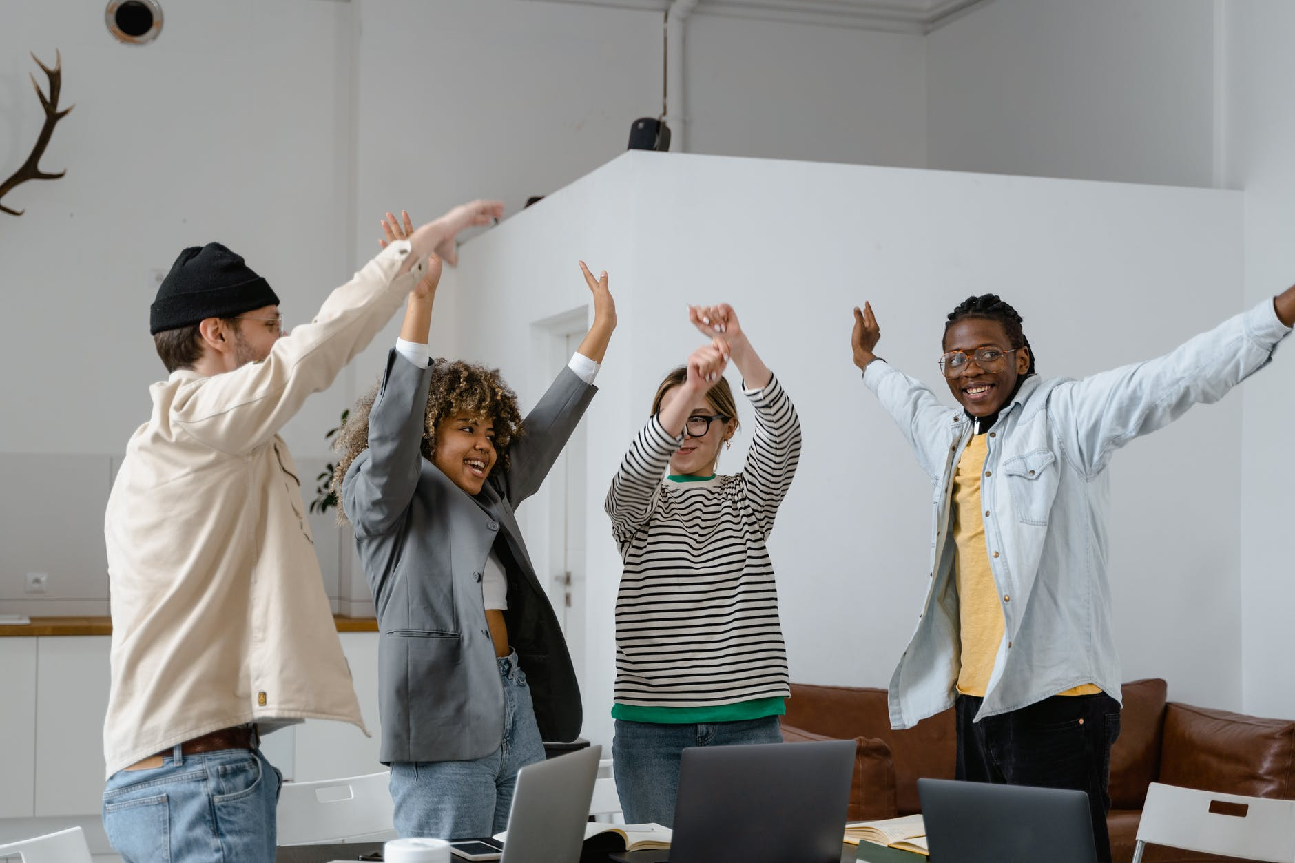 group of interracial people rejoicing with hands raised